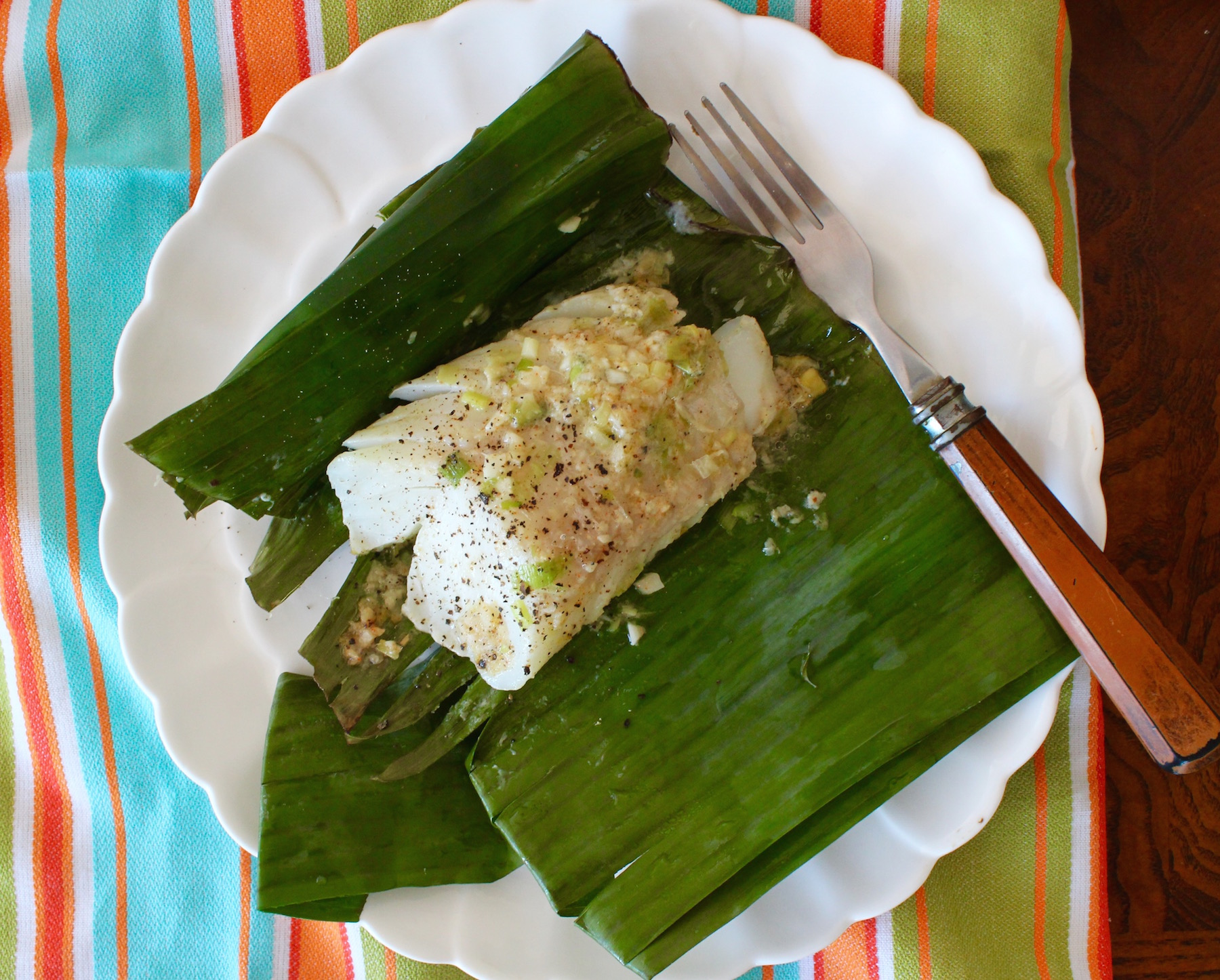 cod in banana leaves on plate