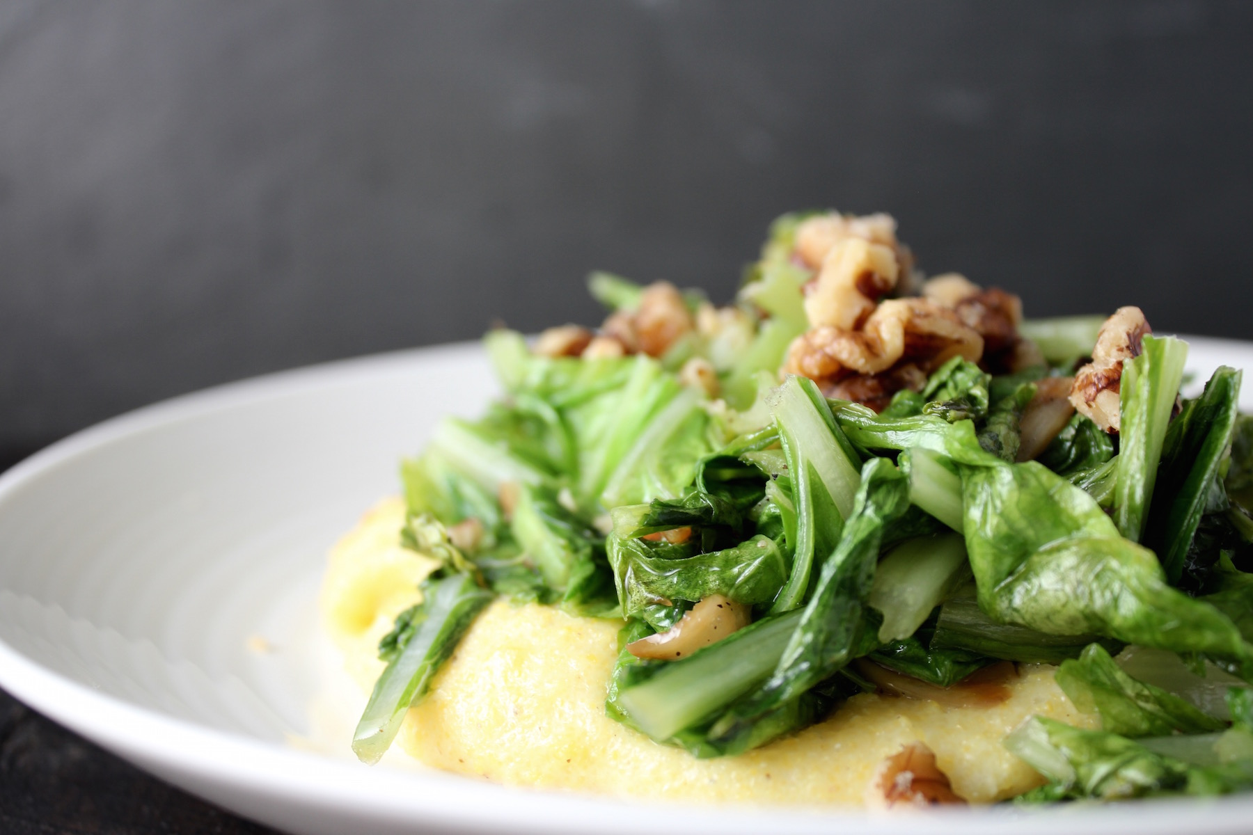 Komatsuna with polenta and walnuts